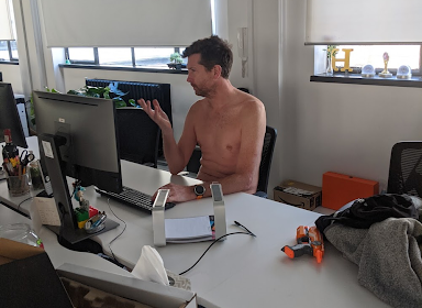 Andrew in the office topless