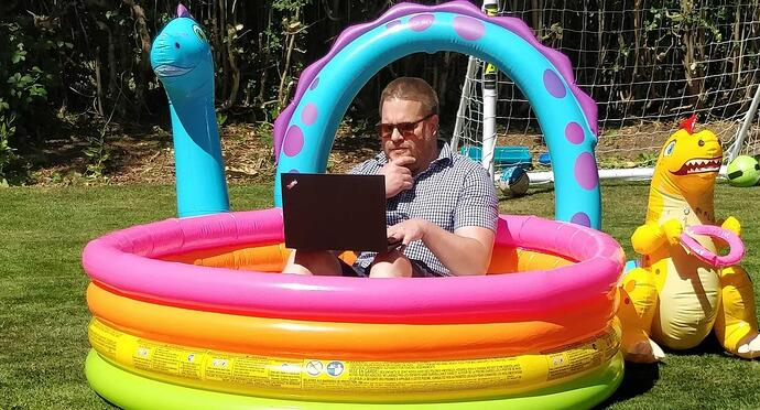 Jonny working in a paddling pool